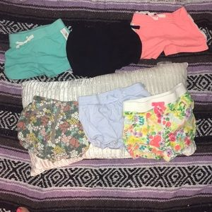 Six pairs of cotton play shorts size 2